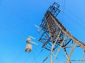picture of voltage  - High voltage electric tower against the blue sky - JPG