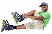 picture of inline skating  - young adult black man posing with rollerblade skates - JPG