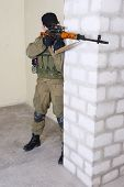 foto of sniper  - insurgent sniper with SVD rifle inside the building - JPG