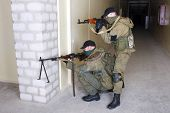 foto of ak 47  - rebels with AK 47 and machine gun inside the building - JPG