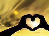 stock photo of romance  - Concept or conceptual heart shape or symbol of human or woman and man hand silhouette over sky at sunset background - JPG