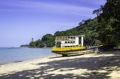stock photo of shipwreck  - Closeup of old shipwreck on the tropical beach - JPG