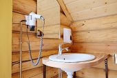 image of mixing faucet  - White wash sink in a bathroom - JPG