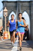 image of brooklyn bridge  - New York runners running training on Brooklyn bridge NYC during busy rush hours with tourists - JPG
