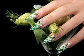 foto of nail-design  - Female hand with manicure and floral design on nails - JPG