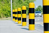 stock photo of stud  - Yellow and black road safety studs with selected focus in a sunny day - JPG
