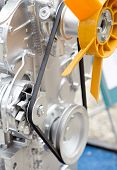 stock photo of lube  - Close up of cooler and transmission belt on tractor engine - JPG