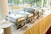 stock photo of chafing  - Closeup catering wedding with heater with buffet line - JPG