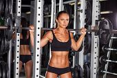 picture of barbell  - beautiful sports fitness girl with a barbell in the gym - JPG