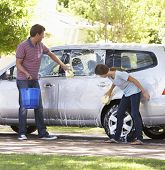 stock photo of car carrier  - Father And Teenage Daughter Washing Car Together - JPG