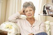 picture of retired  - Unhappy Retired Senior Woman Sitting On Sofa At Home - JPG