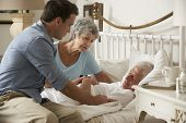 picture of visitation  - Doctor On Home Visit Discussing Health Of Senior Male Patient With Wife - JPG