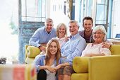 stock photo of extended family  - Extended Family Group At Home Relaxing In Lounge - JPG