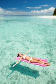 foto of mattress  - Woman relaxing on inflatable mattress in the sea - JPG