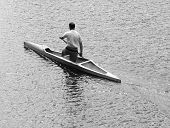pic of canoe boat man  - Young man canoeing in the lake at sunset - JPG