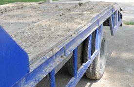 stock photo of dumper  - dirt on the old blue truck dumper for construction - JPG