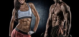 image of human muscle  - Fit woman and man showing her perfect abs - JPG