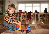 foto of nursery school child  - boy play with toy cor in the preschool