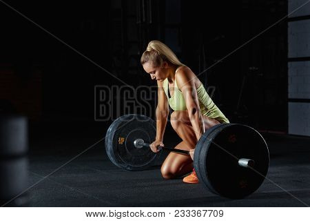 poster of Shot Of A Gorgeous Fitness Woman Preparing For Her Weightlifting Workout With A Heavy Dumbbell. Beau