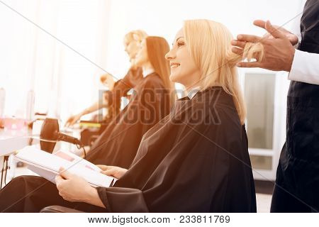 poster of Female Stylist Combs Blond Straight Hair Of Mature Woman In Beauty Salon. Mature Pretty Woman Is Doi