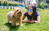 Latin Woman With Sunglasses Enjoying A Quiet Afternoon In The Park With Her Faithful Canine Friend,  poster