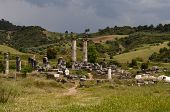 stock photo of artemis  - A rich and beautiful landscape of the rolling hills of Turkey with the ancient ruins of the Temple of Artemis in the foreground - JPG