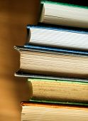 Closeup of stack of antique books educational, academic and literary concept poster