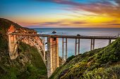 Bixby Bridge Also Known As Rocky Creek Bridge And Pacific Coast Highway At Sunset Near Big Sur In Ca poster