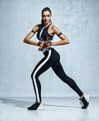 Young Latin Woman Doing Exercise With Dumbbells. Photo Of Sporty Woman In Training Pumping Up Muscle poster