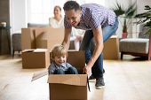 Father Helping Cute Little Son Riding In Box, Happy Dad Playing With Small Boy After Relocation, You poster