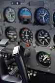 Plane cockpit instruments and indicators. Only steering wheel is in focus, other instruments blured  poster