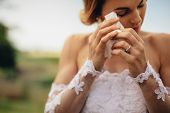 Beautiful Bride In White Dress Weeps Tears Of Happiness On The Wedding Day. Emotional Woman In Weddi poster