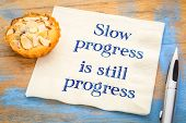 Slow progress is still progress - inspirational handwriting on a napkin poster