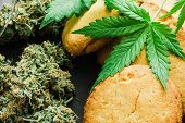 Cbd Cookies With Cannabis And Buds Of Marijuana On The Table. A Can Of Cannabis Buds Concept Of Cook poster