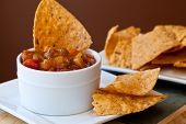 stock photo of chipotle  - Peach Mango Salaso with chipotle Chips  - JPG