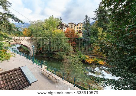 poster of Embankment Of The Passer River In The Fall. View Of The Steinerner Steg Bridge - Oldest Bridge In Th