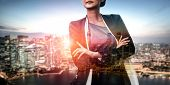 Double Exposure Image Of Business Person On Modern City Background. Future Business And Communicatio poster