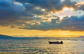Sea with boat at sundown  - Sunset saescape, landscape poster