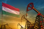 Hungary Oil Industry Concept, Industrial Illustration. Fluttering Hungary Flag And Oil Wells On The  poster