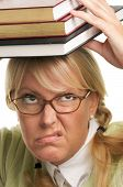 Disgruntled Woman With Stack Of Books poster
