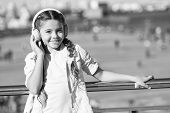 No Music So Sweet As Childs Ringing Laughter. Adorable Music Lover Wearing Wireless Headset. Little  poster