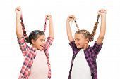 Create Simple But Gorgeous Hairstyle. Happy Children Wear Plaited Hairstyle. Small Cute Girls Hold L poster