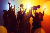 Corporate. A Crowd Of People In Silhouette Raises Their Hands On Dancefloor On Neon Light Background poster