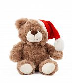 Little Cute Brown Teddy Bear With In A Red Christmas Hat Sits On An Isolated White Background, Holid poster