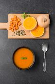 food, new nordic cuisine, culinary and cooking concept - close up of pumpkin cream soup in bowl, spo poster
