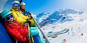 Happy family on ski lift enjoying winter vacations in mountains, Meribel, 3 Valleys, France. Playing poster