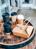 Coffee Cups And Street Food Craft Paper Container On A Wooden Outdoor Table. Street Market Food And  poster