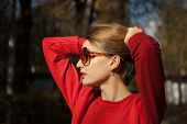 Outdoors Female Portrait Of Attractive Young Woman In Fashionable Sunglasses With Charming Smile, Bl poster