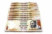 stock photo of mahatma gandhi  - Indian rupees in 1000 banknotes isolated on white - JPG