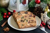 Sweet Christmas Fruit Cake Slices On White Plate Put On Black Granite Table In Side View Copy Space  poster